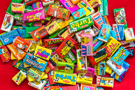 the seventies: ASHDOD, ISRAEL - SEPTEMBER 27, 2015: Many various colorful chewing or bubble gum from seventies, eighties and nineties, including Robocop, Turbo, Donald Duck, BomBibom, TipiTip, X-Men, Dunkin, OtoMoto