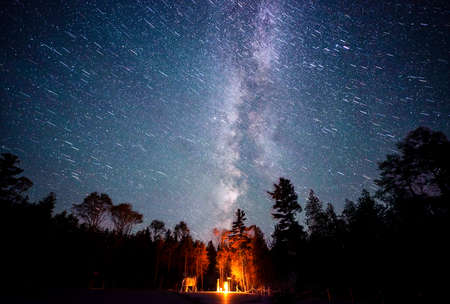 two long exposure shots blended together: one with the astrotracer feature by employed for sharp stars, another traditional star trail long exposure shot to get the sharp foreground