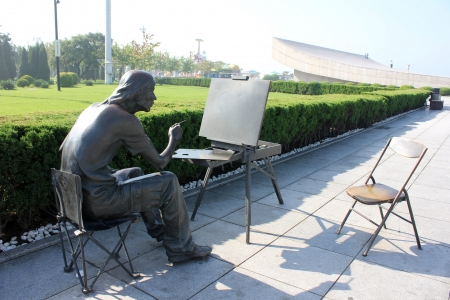 Copper painter of the outdoor sculpture Stock Photo