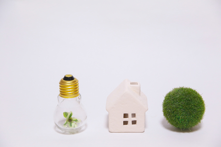 the elderly residence: House and green bulb (right) Stock Photo