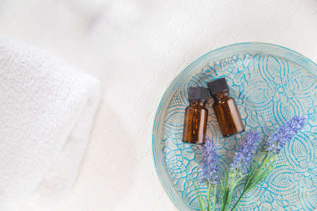 Aroma, two bottles of aromatic oil. Relaxation, beauty image.