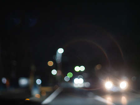 Road at night. Night roads and driveways where street lights and car lights shine. Night city drive.