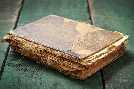 Vintage old book on wooden table Stock Photo