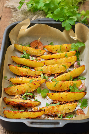 Fried potato wedges with spices and herbs