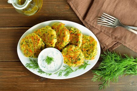 Vegetable cutlet from zucchini, carrot, herbs on wooden table. Top view, flat lay Zdjęcie Seryjne