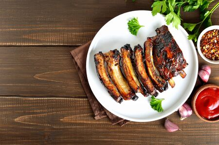 Grilled pork on plate over wooden