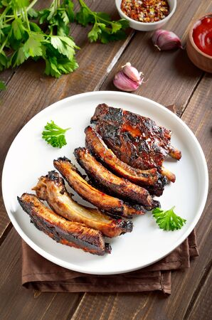 Fried pork on plate on a wooden background Stock Photo - 144136218