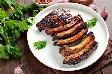 Fried pork ribs on plate, close up view Stock Photo