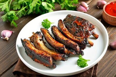 Grilled pork ribs on white plate. Stock Photo