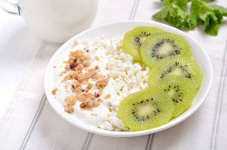 Cottage cheese with yogurt and kiwi slices Stock Photo
