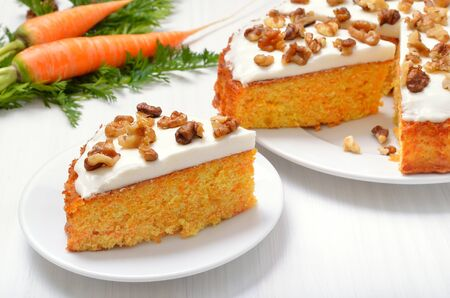 Appetizing piece of carrot cake on white plate Stock Photo - 144994873