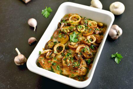 Stew chicken breast with creamy mushroom sauce in white bowl