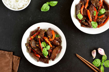Thai beef stir-fry with pepper and basil in bowl. Top view, flat lay Stock Photo - 152490146