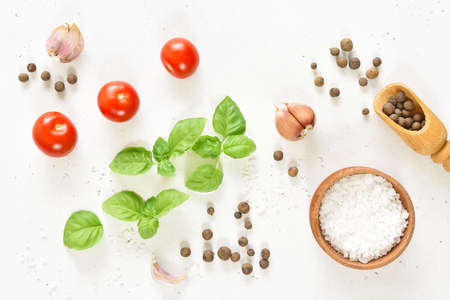 Fresh tomatoes, basil and spices on white stone background. Top view, flat lay Stock Photo - 152490153