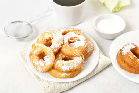 Apple rings on plate on white table