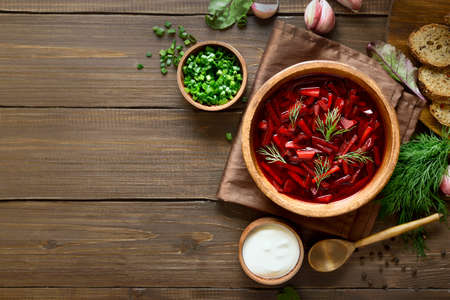 Traditional ukrainian russian soup (borscht) over wooden background with free text space. Top view, flat lay 스톡 콘텐츠