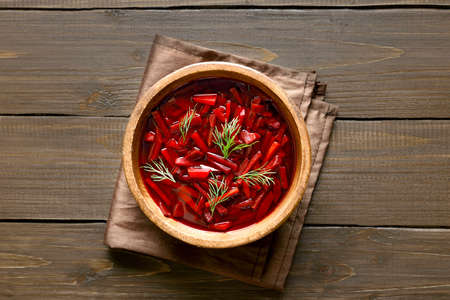 Traditional ukrainian russian soup (borscht). Beetroot soup in bowl. Top view, flat lay