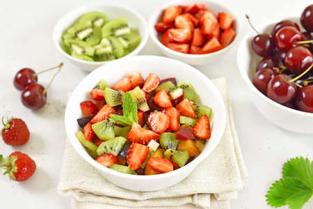 Healthy food fruit salad from kiwi and strawberry in bowl
