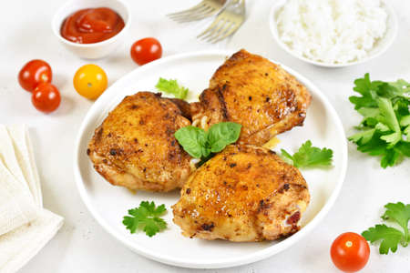 Roasted chicken thighs in white plate 스톡 콘텐츠