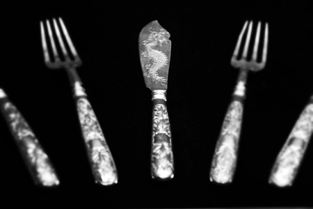 Set of silver cutlery on display in a museum Editorial