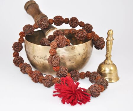 singing bowl: Tibetan Singing Bowl with beads and metal bell on a white background