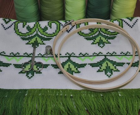 thread count: traditional Ukrainian embroidered towel bright green thread in hoop