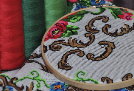 thread count: Detail of traditional Ukrainian embroidery towels in the wooden embroidery hoop, cross-stitch