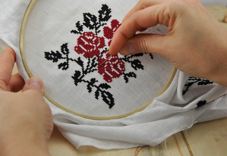 Hand embroidery cross pattern in the wooden hoop