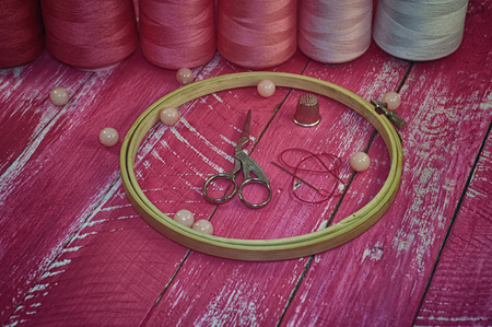 iron hoops: Vintage photos of objects for needlework in pink tones Stock Photo