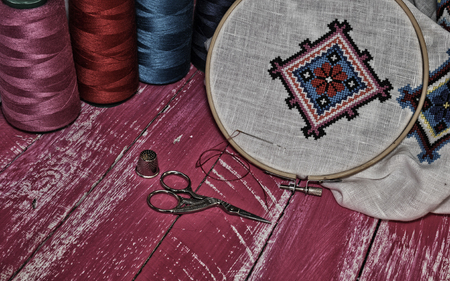 needlecraft product: Vintage photos of objects for needlework in pink tones Stock Photo