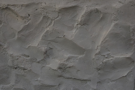 mounds: fragment of gray cement wall texture, large mounds
