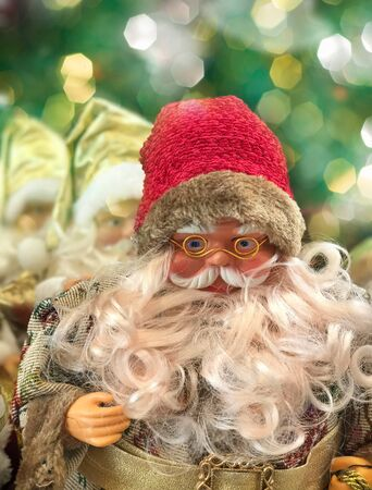 Smiling Santa Claus on a blurred background Group of Santa Clauses Stock Photo