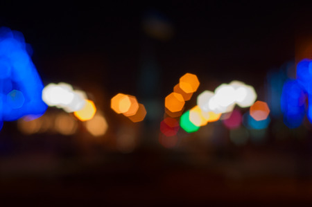 Blurred Background night street with bright illumination, a large bright bokeh