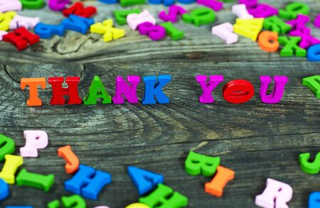 inscription thank you to you from the multicolored wooden small letters, selective focus Stock Photo