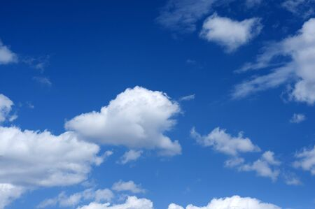 Cumulus white clouds against blue sky in spring