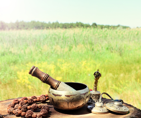 Singing a copper bowl and religious items for meditation and alternative medicine