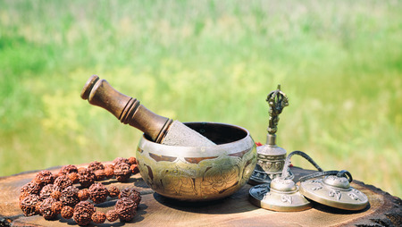 bronze Tibetan singing bowl and other objects for meditation Stock Photo