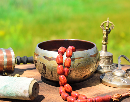 Tibetan copper singing bowl with stone rosary