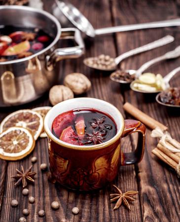 drink mulled wine in brown ceramic mug, top view