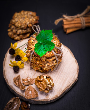biscuit oatmeal flakes, bananas and walnuts on a wooden stand, top view