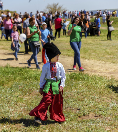 Kherson, Berislavsky district, Republicanets village, National nature park Kam'janska Sich , UKRAINE - APRIL 30, 2018: little boy in national Ukrainian clothes of red trousers and an embroidered shirt Editoriali