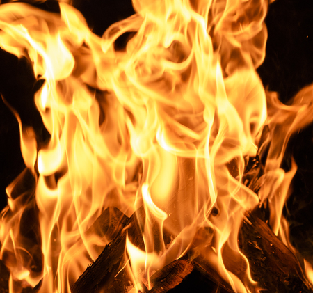 bright orange and yellow flames on a black background,close up Stok Fotoğraf