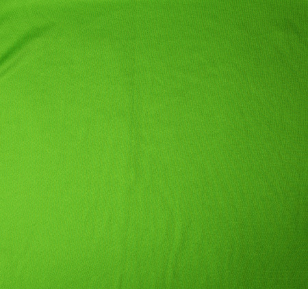 green stretching soft fabric, full frame, close up Stock Photo