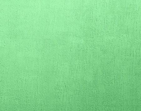 fragment of green cement wall with irregularities, full frame