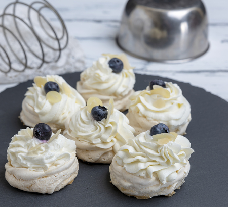 baked round meringues with whipped cream, close up Stock Photo