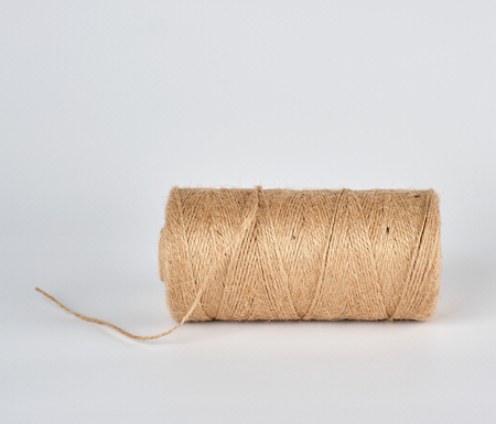 brown rope of jute, white background