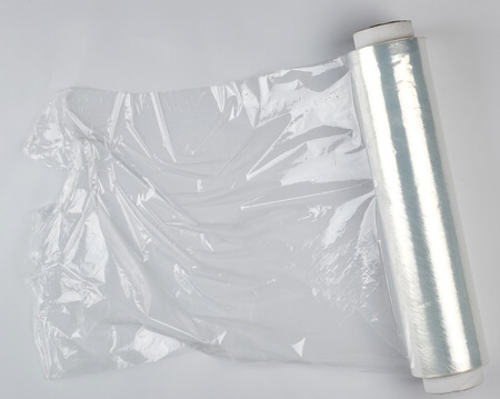 big roll of wound white transparent film for wrapping food, top view