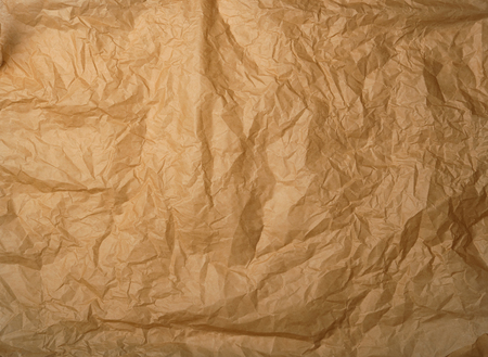 crumpled brown baking parchment paper, full frame