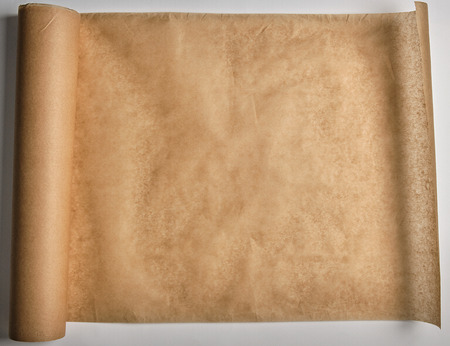 brown parchment baking paper wound into a large roll,  top view