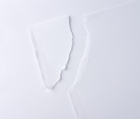 cut off corner from a blank white sheet, close up